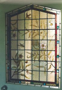 This beautiful Edwardian window was restored after being shattered when a teenager put his foot through it as well as having been painted over with white leaded paint in earlier days when its beauty was not appreciated.